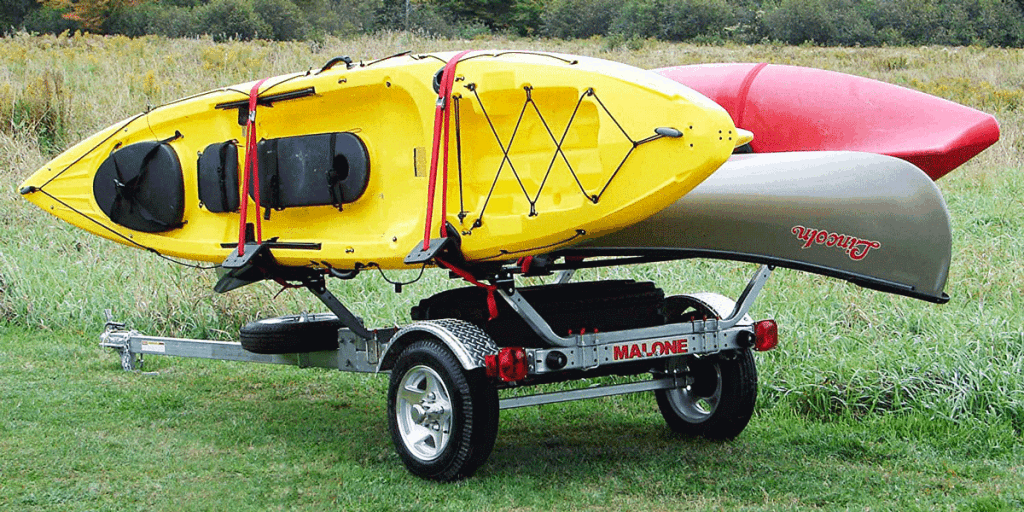 Malone trailer carrying gray,red and yellow kayaks