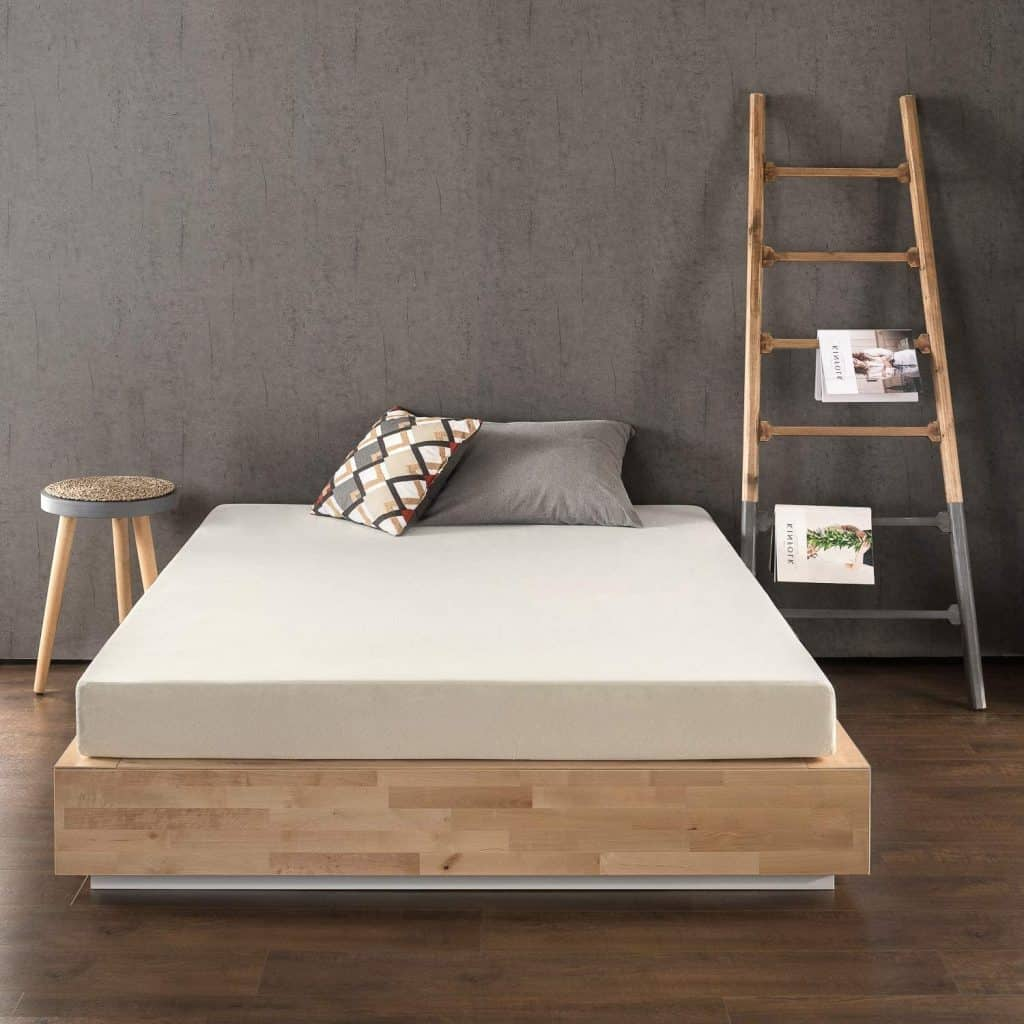 White mattresses with wooden ladder and stool beside