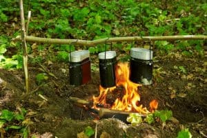 mess kit in a wood over fire