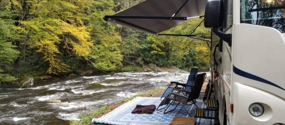 camping car with portable chairs and mattresses
